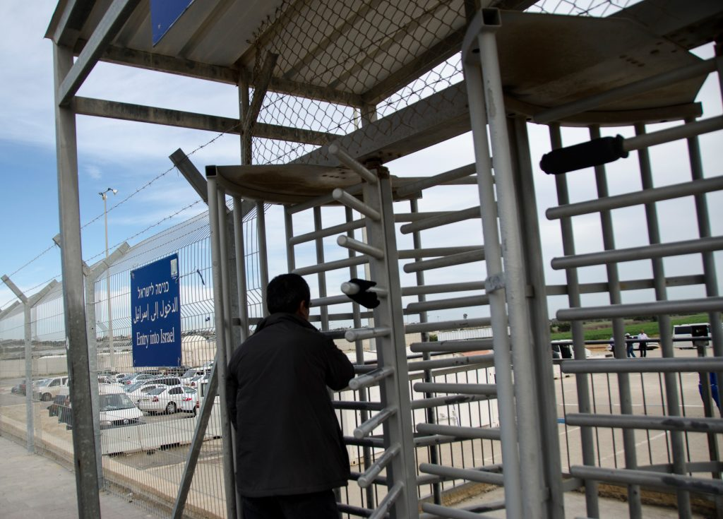 A Palestinian woman going through a metal gate at Erez/Beit Hanoun crossing between Israel and the Gaza Strip.