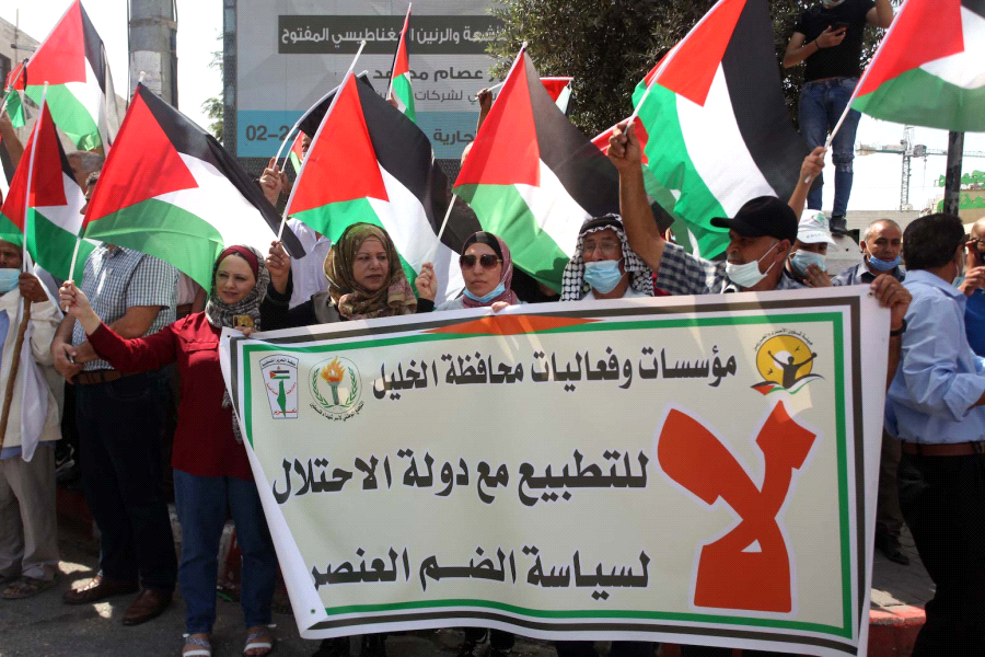 Palestinians holding a protest in Hebron against the UAE and Bahrain normalization of relations with Israel. (WAFA Images / Samar Bader)